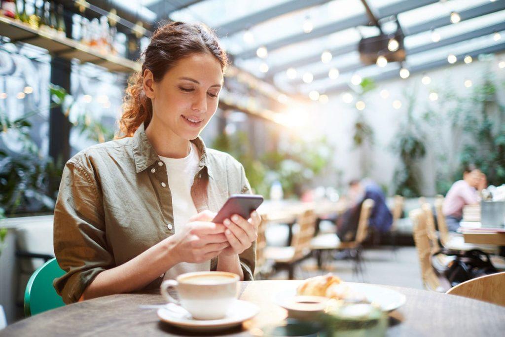 Woman dining using phone